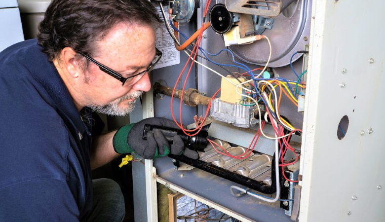 Professional Looking at Furnace