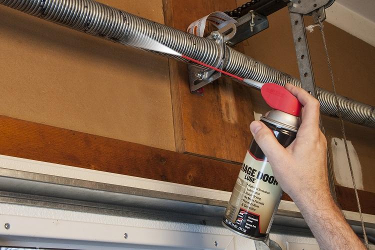 Step 1: Lubricate the garage door mechanisms